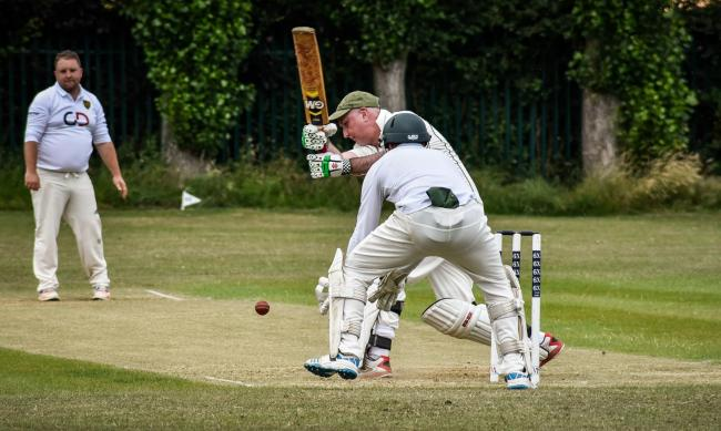 Neil Harbour deals with tricky ball from Lance Howard. .Cricket action Beehive Southwick v Warminster 2nds (fielding) Photo by www.gphillipsphotography.com GP1711.