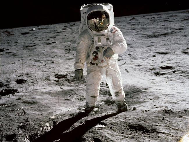Buzz Aldrin on the moon in a picture taken by Neil Armstrong (seen in the reflection)