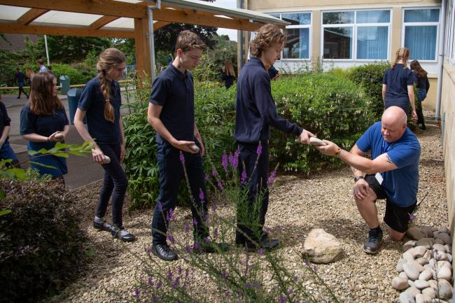 Pupils placed a stone onto a cairn in memory of the victims of the Holocaust