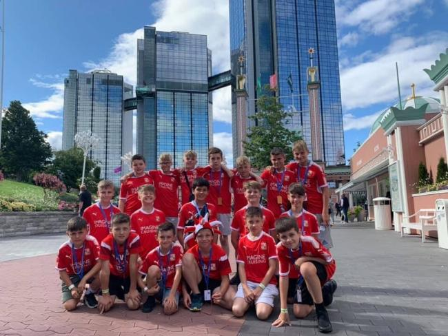 The Swindon Town Football in the Community Trust players with their medals from the 2019 Gothia Cup
