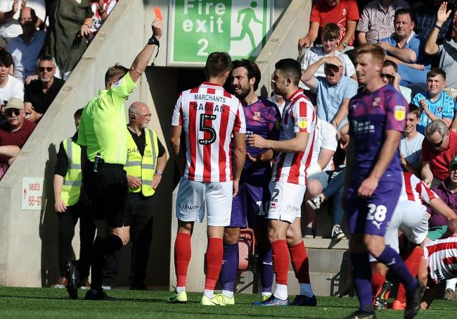 Cheltenham v STFC      Pic Dave Evans     24/08/2019.Trevor Kettle shows a red card to Town's Michael Doughty.