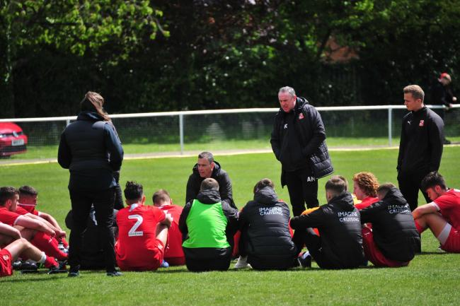 Swindon Town U18 boss David Farrell delivers his final team talk of the season on the Abingdon pitch. PICTURE: SHAUN REYNOLDS