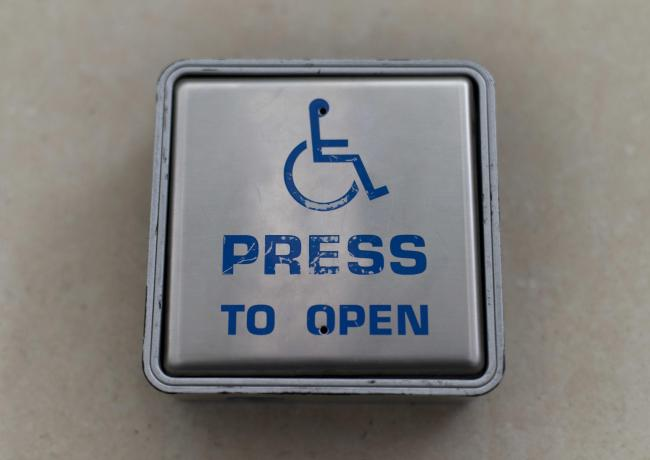EMBARGOED TO 0001 MONDAY JULY 08 File photo dated 18/3/2016 of a wheelchair access door entry button. Disabled rail passengers will benefit from a £20 million fund to boost accessibility, the Department for Transport (DfT) said..