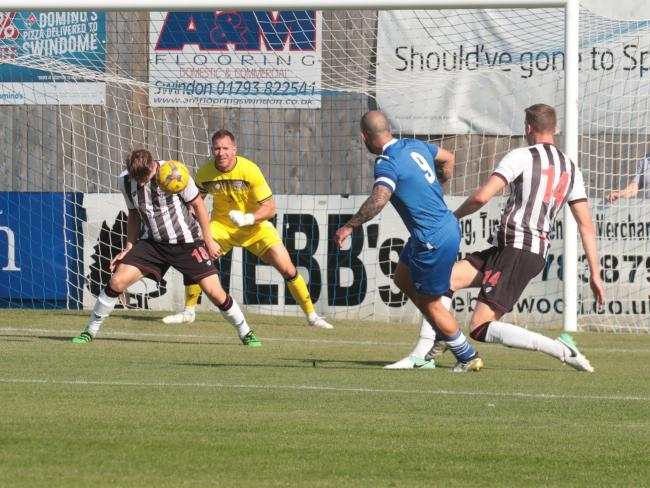 Stuart Fleetwood shoots for Marine, but sees his effort headed over by a Bath defender. PICTURE: Jeff Youd