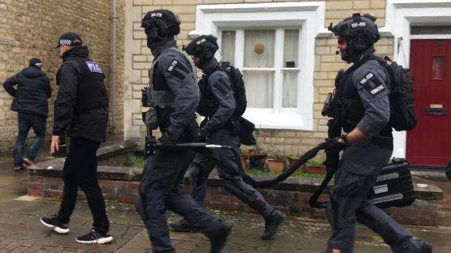 Armed police raid a house on Oxford Street, Swindon, on October 7, 2019