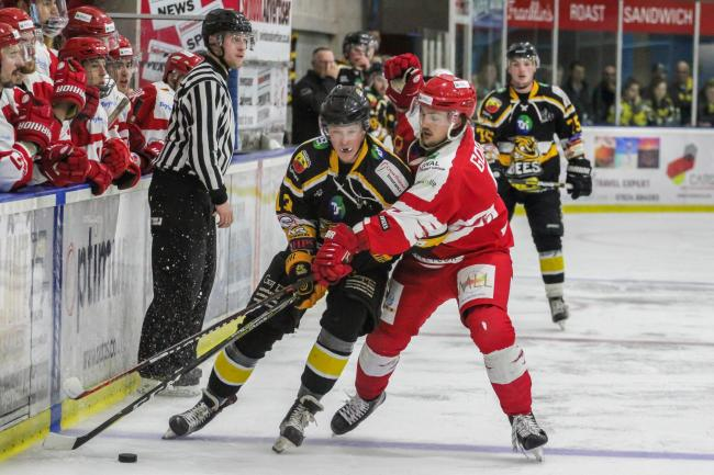 Swindon Wildcats' Sam Godfrey (red) battles for the puck during Saturday night's 5-0 win at home to Bracknell Bees     Picture: KAT MEDCROFT