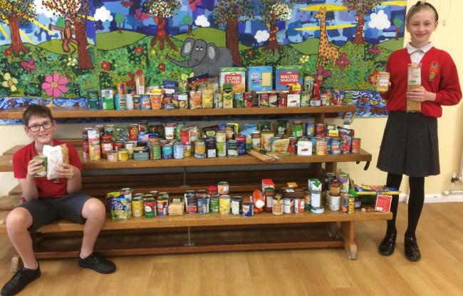 Seend School head boy and girl Riley and Amelia show off the generous donations