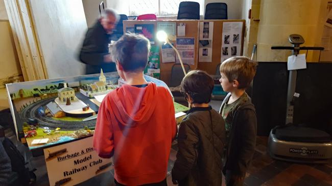Children viewing The Burbage and District Model Railway Club model