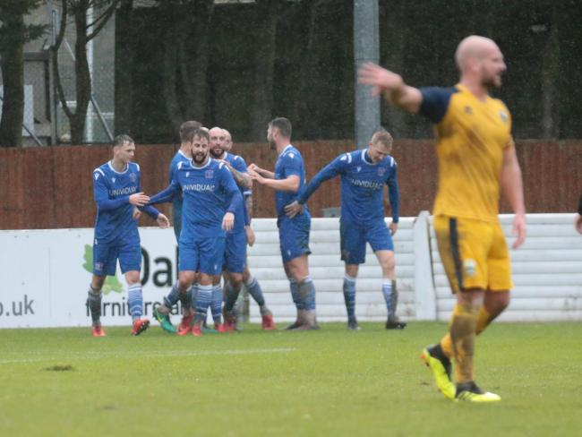 The Swindon Supermarine players celebrate Stuart Fleetwood's winning goal against Gosport Borough last weekend. PICTURE: JEFF YOUD