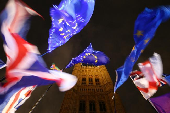 Flags at the foot of the Elizabeth Tower, at the Palace of Westminster in London. PRESS ASSOCIATION Photo. Picture date: Monday October 21, 2019. See PA story POLITICS Brexit. Photo credit should read: Jonathan Brady/PA Wire.