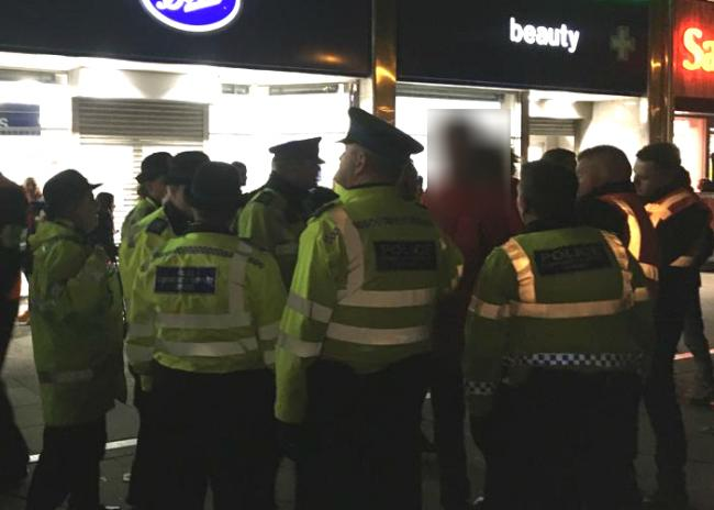 Police make an arrest shortly after the lights switch-on event