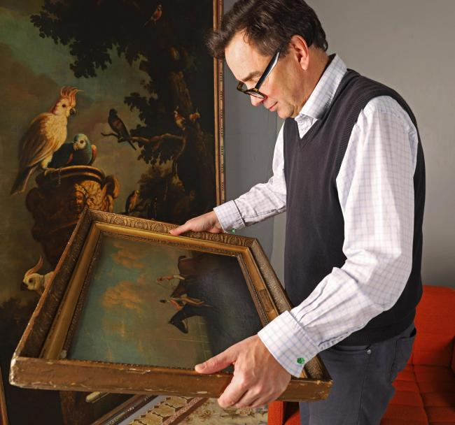 James Harvey, of The Auction Hub in Westbury, values a painting for sale