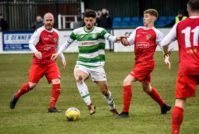 William Thomson battling for Westbury..Action from Westbury United  v Cadbury Heath.  (red strip) Photo by www.gphillipsphotography.com GP1818.