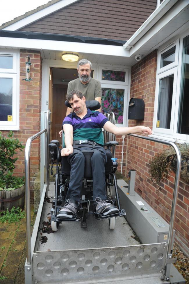 Disabled John Morrison with the wheelchair  on the ramp at his West Lavington home with father  Malcolm. Photo Trevor Porter 66682 5..
