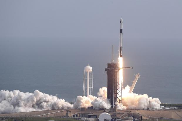 The Falcon 9 SpaceX rocket lifts off