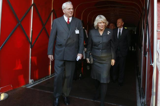 Sir Chips Keswick, pictured with the Duchess of Cornwall, has retired from his role as Arsenal chairman