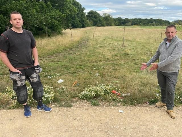 Castle Mead residents Simon Helps and Stewart Benford show litter in the public open space near the play area
