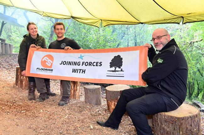 Nathan Pritchard, from Flooring Superstore, with Woodland Warrior programme founders Nick and Louise Goldsmith