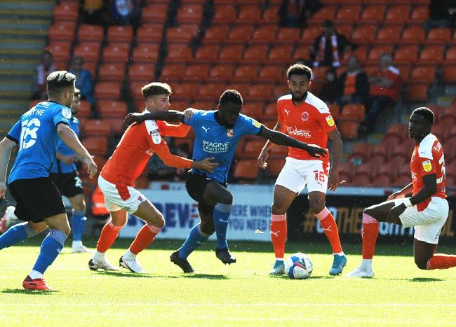 Diallang Jayesimi mounts a Town attack during his side's 2-0 defeat to Blackpool on Saturday