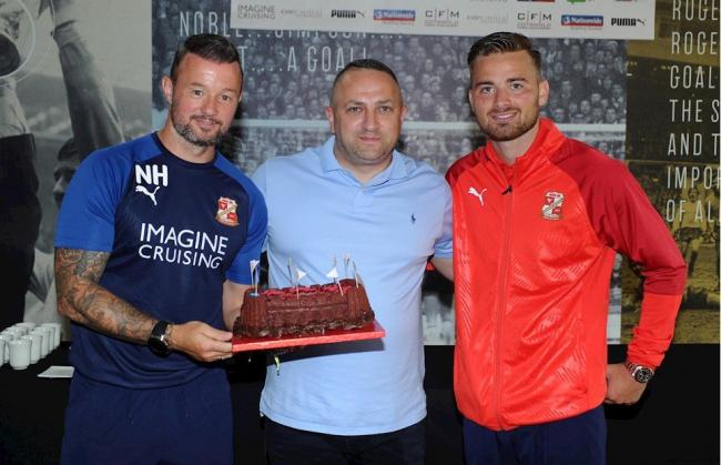 Former Swindon Town assistant manager Noel Hunt, Verelogic CEO Kevin Metcalfe (centre), and Swindon Town midfielder Jordan Lyden