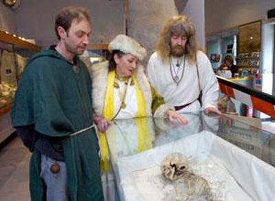 This Is Wiltshire: Druids Paul Davis, Denise Price and Steve Bust with the child's skelton