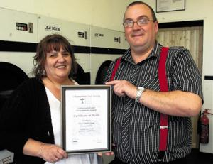 Tony and Phyllis Knaggs with their civic award for renovating the Harris Launderette