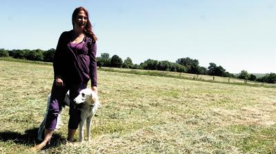 Sue Shepherd-Cross with her dog Sirius on the site of Marden Henge where a six week exploratory dig is about to begin