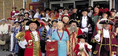 This Is Wiltshire: Warminster town crier Phil Seddon gathers the town criers and escorts with deputy mayor Pip Ridout, centre.                     Photos: Glenn Phillips (39351)