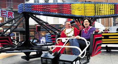 This Is Wiltshire: MP Claire Perry goes for a spin on one of the fairground rides with Marlborough Mayor Andrew Ross          (32833/10) PICTURES BY ADAM DALE
