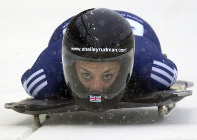 This Is Wiltshire: Shelley Rudman slides during her first run in Whistler this morning