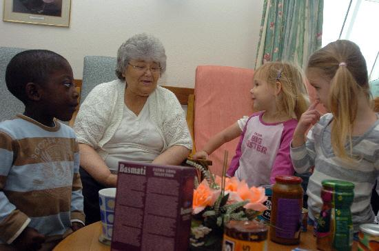 This Is Wiltshire: Bright Start Day Nursery pupils presenting gifts to pensioners