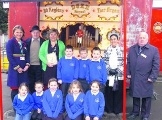 This Is Wiltshire: Back row, from left, Laura Myers of Childrens Services; John Days of Jennings Fair; author Debra Tomlinson; pupils Ronnie, Arthur and Isaac; Louise and Billy Whitelegg from the fair; front row, pupils Anna, Dennis, Taiya, Maisy and Cherise