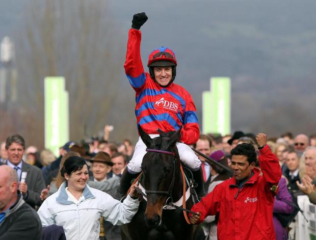 This Is Wiltshire: Barry Geraghty celebrates his Arkle Trophy victory on Sprinter Sacre in March