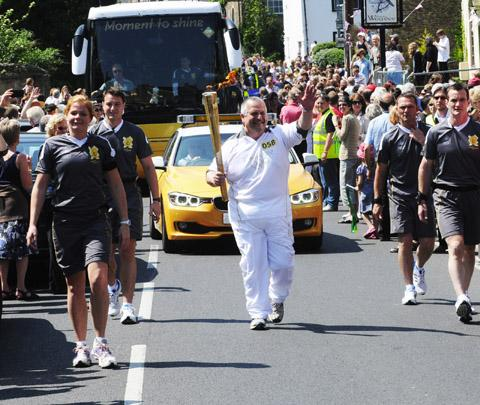 This Is Wiltshire: Matthew Leighton-Fry carries the torch