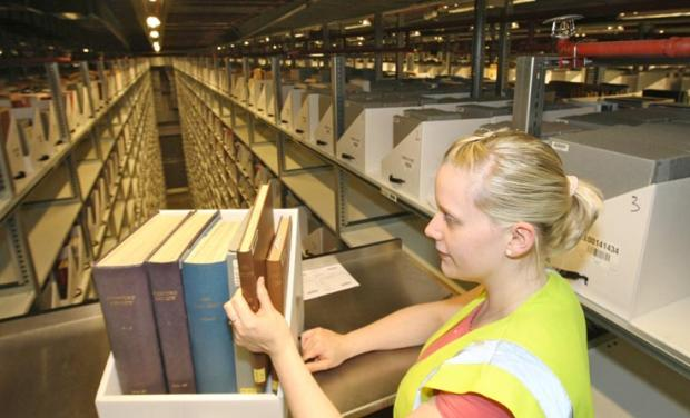 This Is Wiltshire: Warehouse assistant Kelci Finucane with some of the 7.5 million books