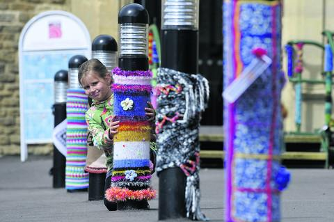 Hollie Hyde, nine, was among those admiring the yarn bombers' work in Corsham on Saturday