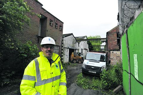 This Is Wiltshire: Stuart Morgan of Ashford Homes at the derelict factory site infested with pigeons