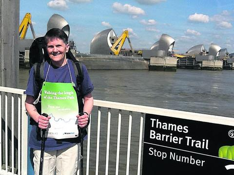 This Is Wiltshire: Sue Reed pauses during her Thames Path charity walk