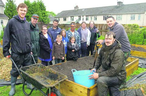 This Is Wiltshire: Gary Lamont, front left, from Wiltshire Wildlife Trust, and volunteers at the community garden