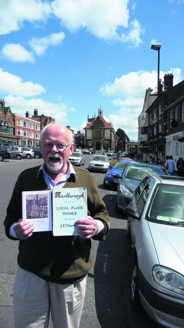 This Is Wiltshire: David Chandler with his new book, left, and his father Jesse's original version of Marlborough – Local Place Names