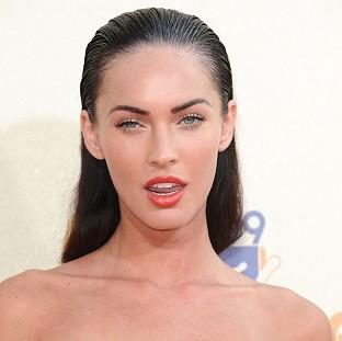 This Is Wiltshire: Megan Fox was pictured in Hawaii, where the couple had married