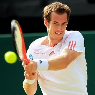 This Is Wiltshire: Great Britain's Andy Murray has beaten Croatia's Ivo Karlovic at Wimbledon