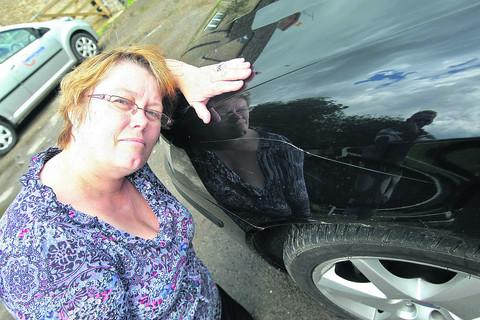 This Is Wiltshire: Lesley Gardner is angry with the repeated vandalism to her cars outside her home in Ashton Keynes