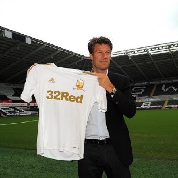 This Is Wiltshire: Swansea manager Michael Laudrup is believed to have secured the signing of Michu