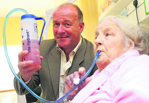 This Is Wiltshire: Inventor Mark Moran with patient Patricia Simmonds at the GWH last year