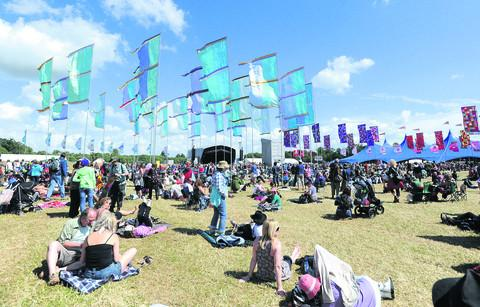 This Is Wiltshire: Crowds at WOMAD festival in Charlton Park, Malmesbury