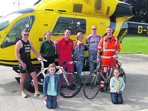 This Is Wiltshire: Local triathlete Chris Roxburgh (left) with paramedics and A&E staff, who will compete in the Trowbridge Triathlon to raise money for Wiltshire Air Ambulance on Sunday