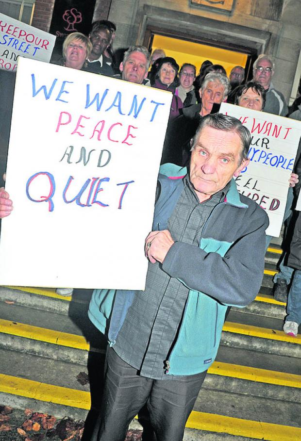 This Is Wiltshire: Protesters against plans for a late night pharmacy in Gorse Hill met outside of the Civic Offices in November. Centre front is Gerry Przybyszewski