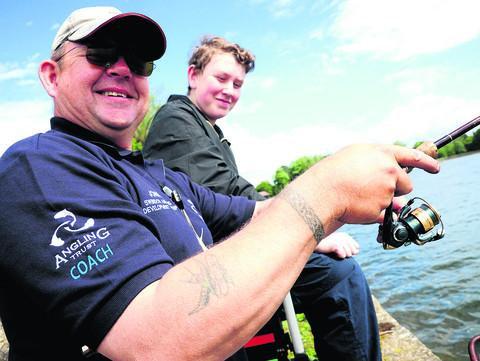 John Kiddle and  Jaye Tuck enjoy the angling taster day at Coate Water