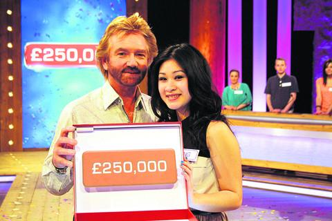 Nong Skett, 21, from Swindon, pictured with Deal or No Deal presenter Noel Edmonds after scooping £250,000 in the popular television show